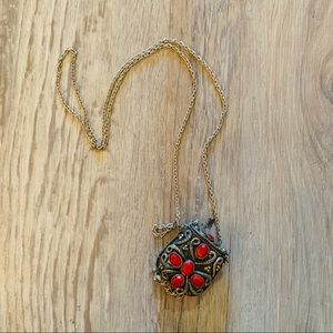 Necklace with hidden compartment